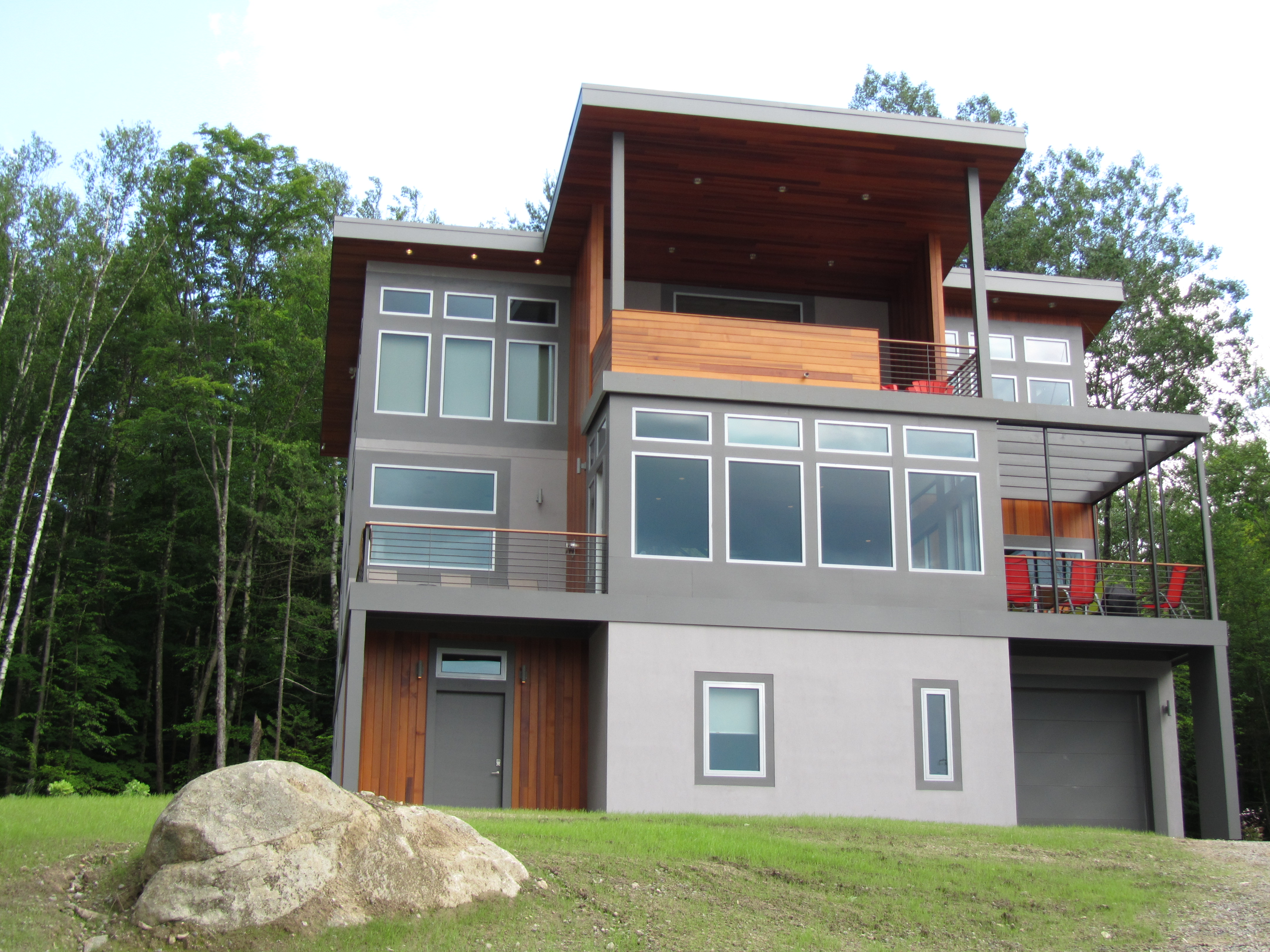 The house leisure house where the sleek design of a soho loft meets the adirondacks this modern 3 story home features expansive lake and mountain views